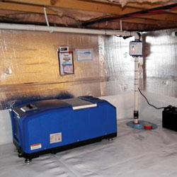 An energy efficient crawl space dehumidifier system installed in a narrow crawl space