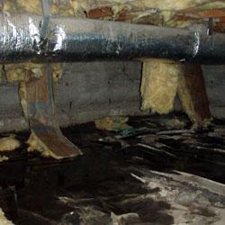 wet fiberglass batt insulation falling from the floor joists