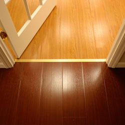Synthetic wood flooring installed on a concrete basement floor