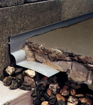 a custom designed basement drain system for thin basement floors.