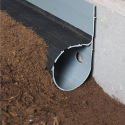 A drainage system installed along the interior perimeter of the crawl space