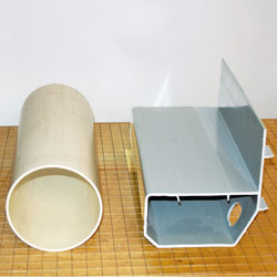 Our basement drain system compared to round PVC pipe.