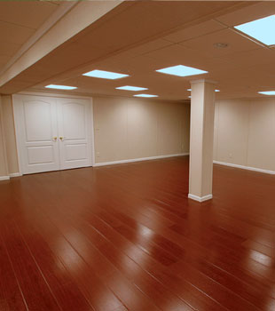 A basement finished with a synthetic wood flooring system.