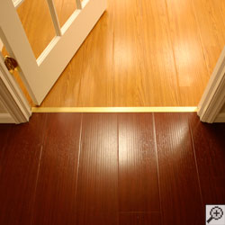 Wood laminate flooring installed on a basement floor.