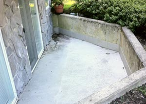 A concrete patio surface about to be specially cleaned and protected with our concrete coating product.