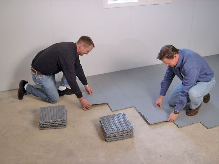 Waterproof basement floor matting installation in Salem, OR