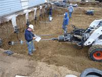 Piers installed; installing helical tiebacks
