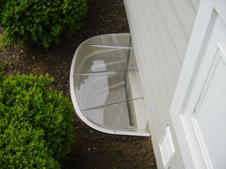 Covered plastic basement window well system