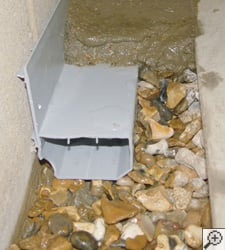 A no-clog basement french drain system installed in Longueuil