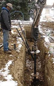 Installation d'une pile de vis hélicoïdale en hiver a Montréal