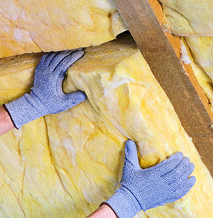 Garage Insulation being installed for increased energy efficiency by out expert contractors