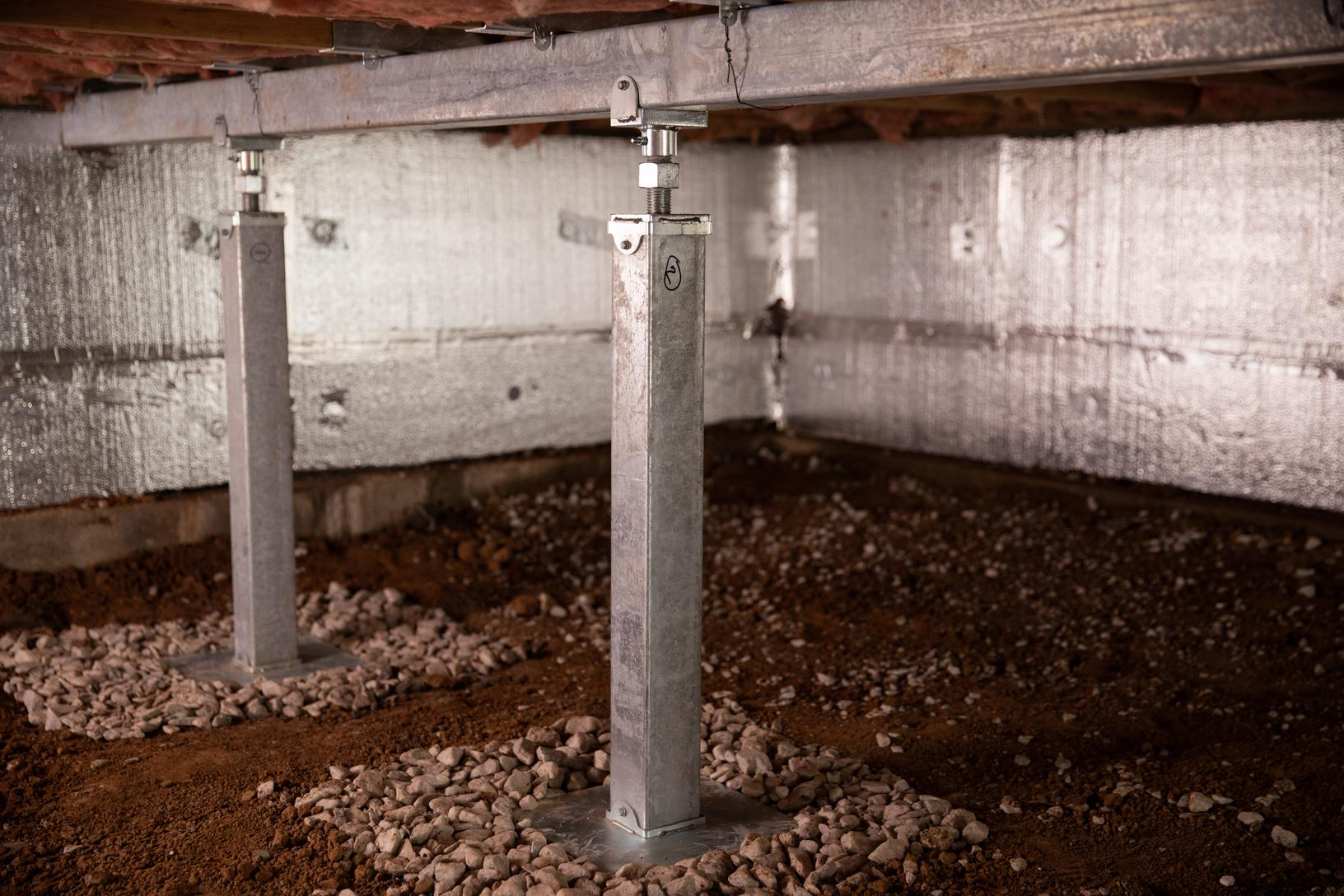 A system of crawl space support posts adding structural support to a crawl space in Acton