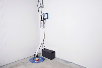 A sump pump system with a battery backup system installed in Tillsonburg