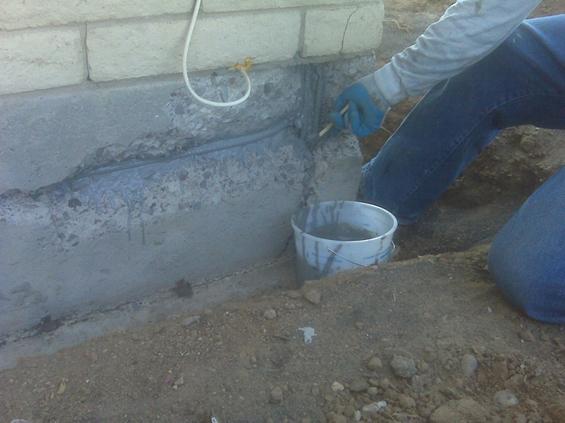Sandblasting and coating the rebar with ion blocking epoxy