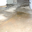 a huge crack in a concrete slab floor in Glendale