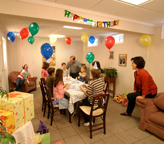 a party in a finished basement space with children
