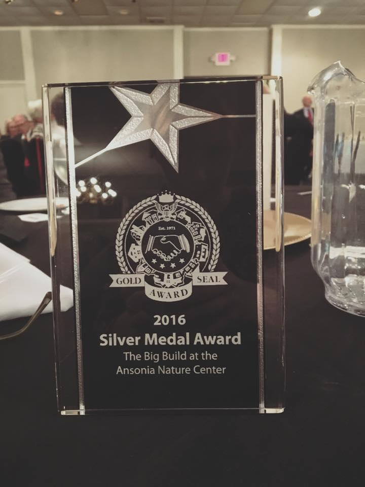 Larry Janesky award the Valley of Chamber of Commerce's Silver Medal Award