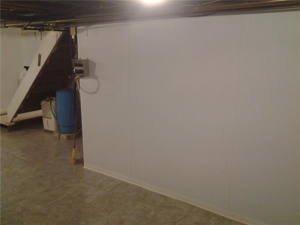 Basement Wall and Floor Installation in Northville, NY - After Photo