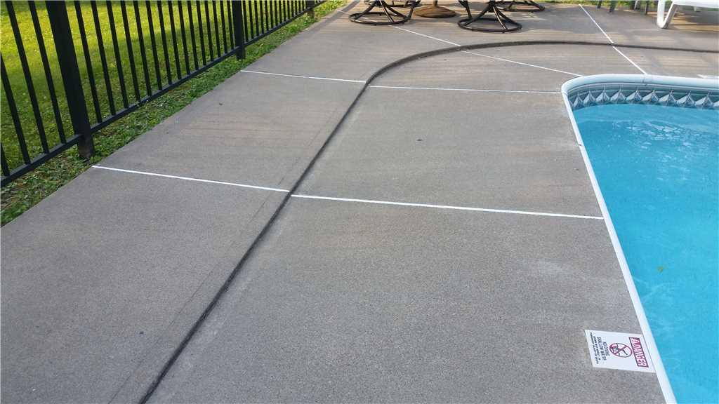 Leveling a Pool Patio in Delmar, NY - Before Photo