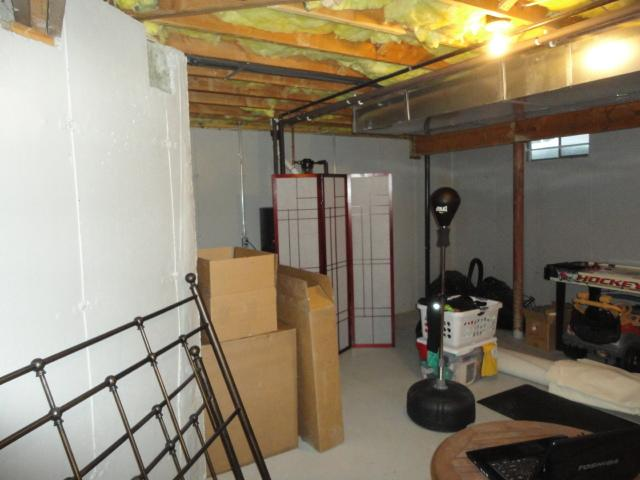 Total Basement Finishing Transformation in Oxford, CT - Before Photo