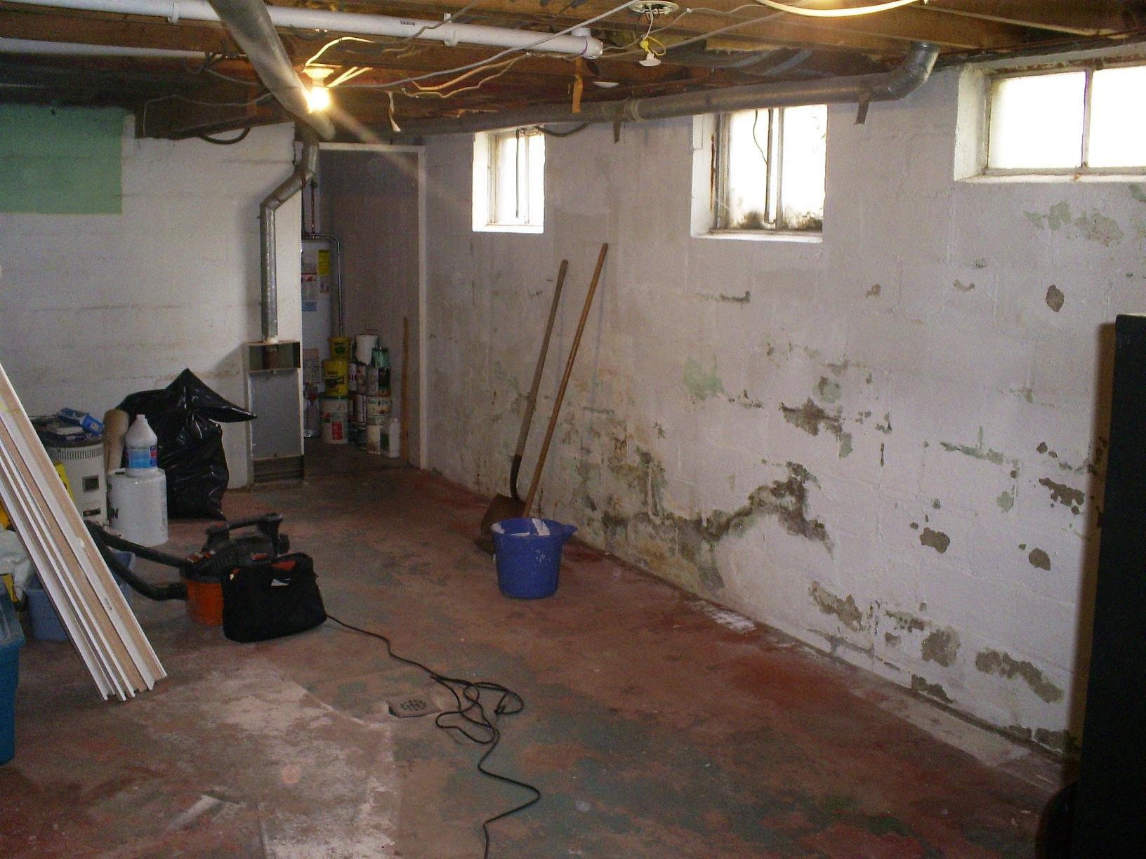 Wet and dark basement turned into prime living space in West Harrison, NY!  - Before Photo