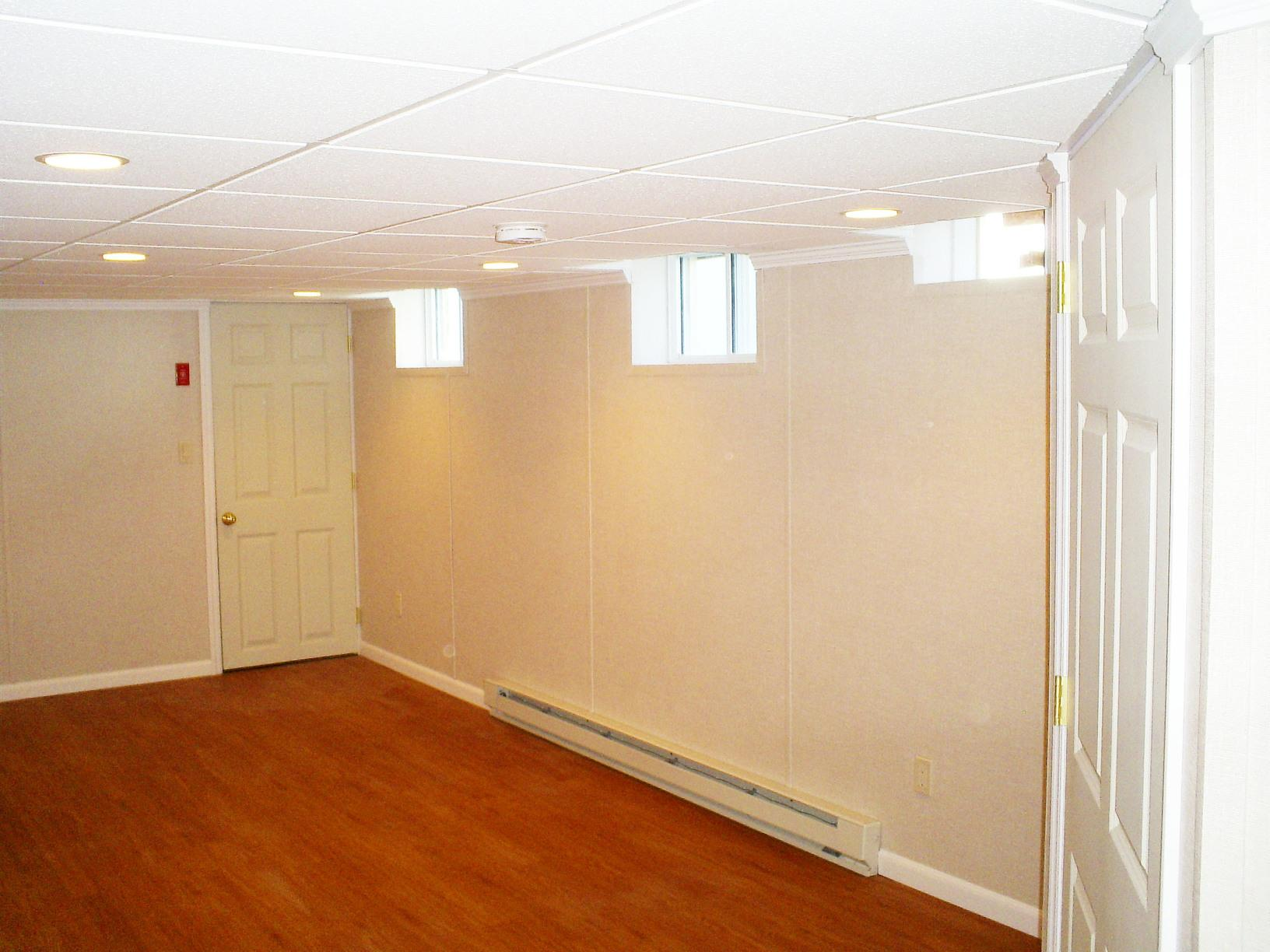 Wet and dark basement turned into prime living space in West Harrison, NY!  - After Photo
