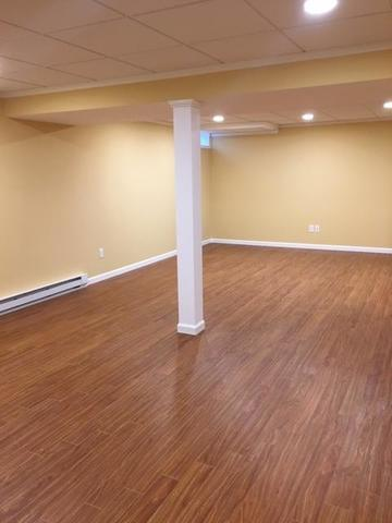 Light Pecan ThermalDry Flooring and Paintable EverLast Wall Panels in Madison, CT
