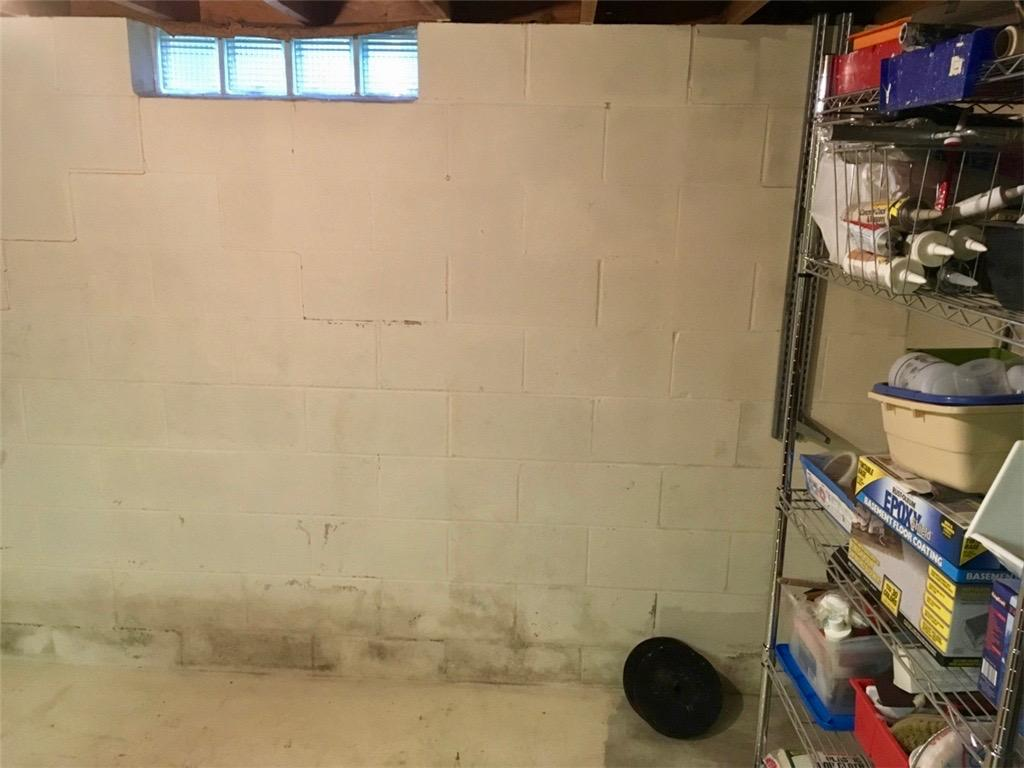 Basement Wall Crack Repair in Rochester, MN - Before Photo