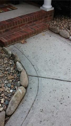 Sidewalk Sinking by the Porch in Terrell, NC