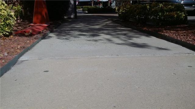 Hotel sidewalk trip hazard Cornelius, NC