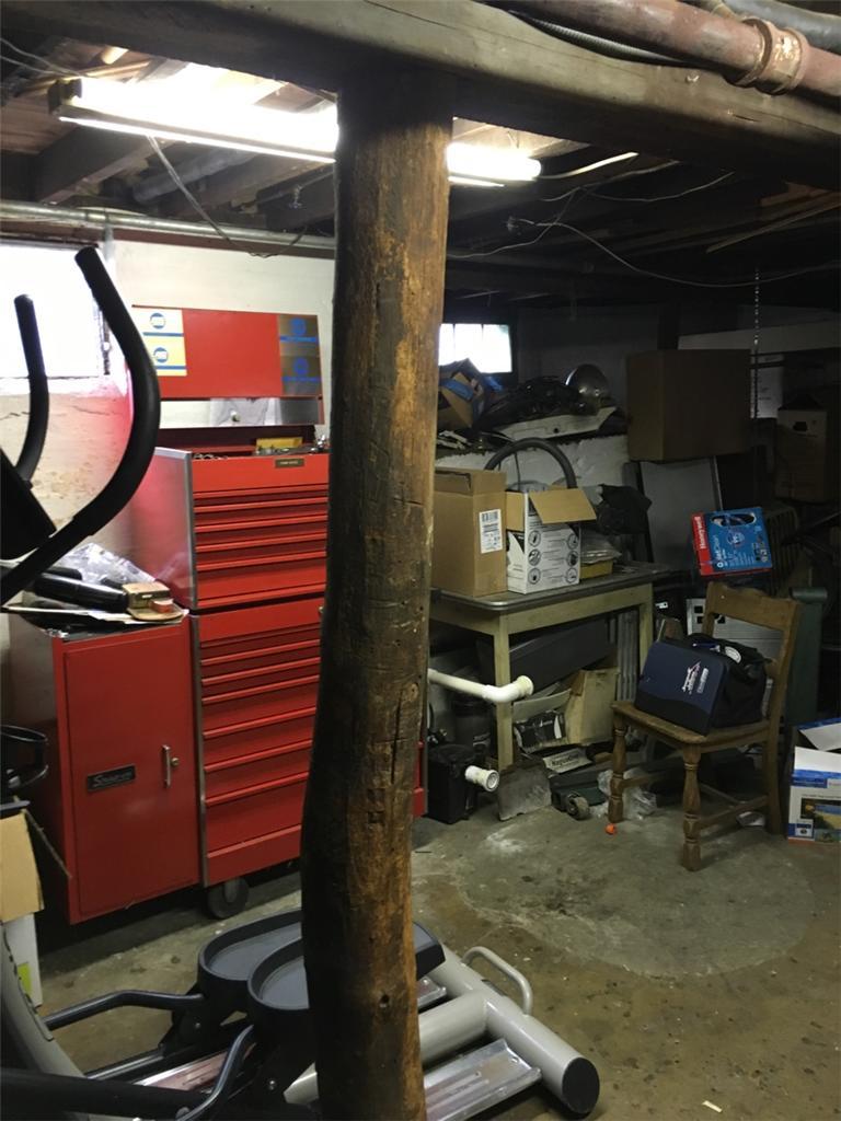 SmartJacks Stablizie Floor Joists in Hickville, NY Basement - Before Photo
