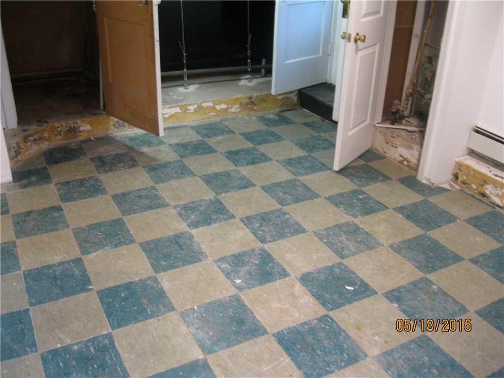 Water Seeping Through Floors in Long Beach is Fixed - Before Photo