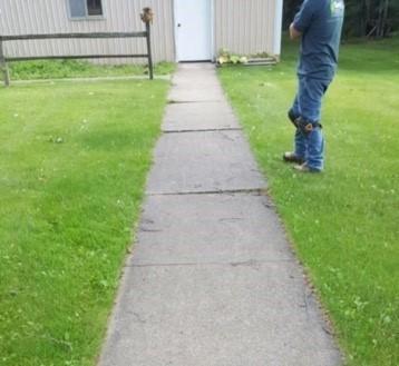 Uneven sidewalks in Gwinn, MI - Before Photo