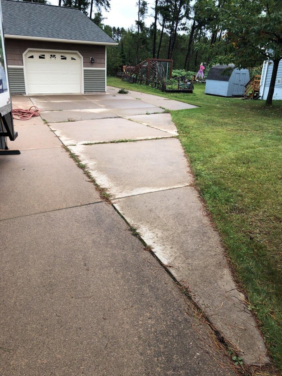 Sealing and Stabilizing a Driveway in Marquette, MI - Before Photo