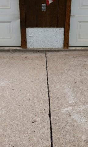 Restoring and Protecting Driveway in Gwinn, MI - Before Photo