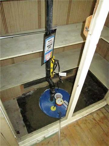 Installation d'un système de pompe de puisard et d'un système de déshumidification à Montréal-Est !