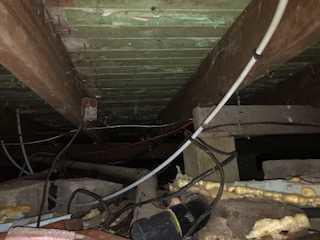 Infiltrations d'eau dans un vide sanitaire à Saint-Zotique - Before Photo