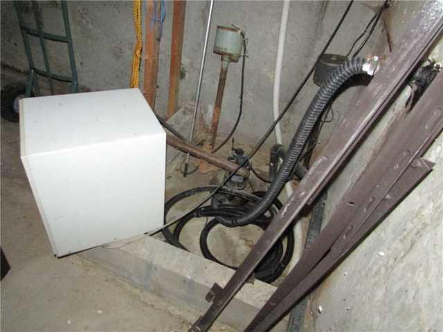 Un changement de système de pompe de puisard à Sainte-Martine - Before Photo