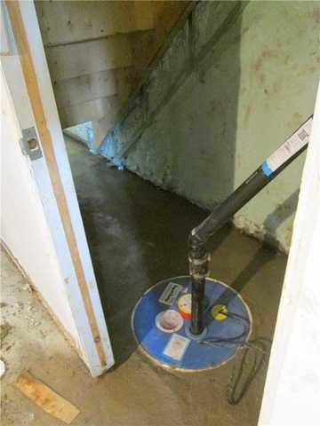 Replacing an old sump pump in Saint-Jerome, Qc