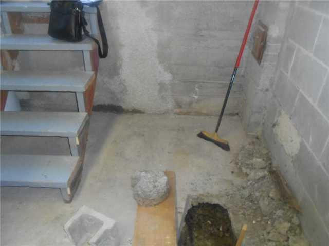 Installing a basement waterproofing system in Outremont, Qc
