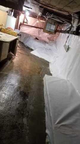 Transformer un sous-sol mouillé en un espace sec à Morin-Heights, QC