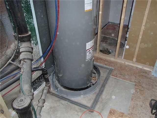 Protection du chauffe-eau dans un sous-sol à Richmond, QC