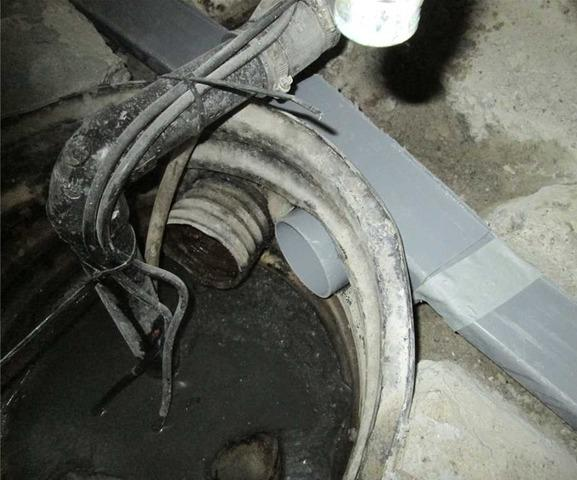 Replacing an old sump pump with our SuperSump pump system in Hudson, Qc
