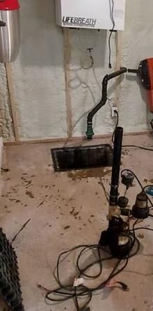 Changing of a sump pump in Beaulac-Garthby, Qc
