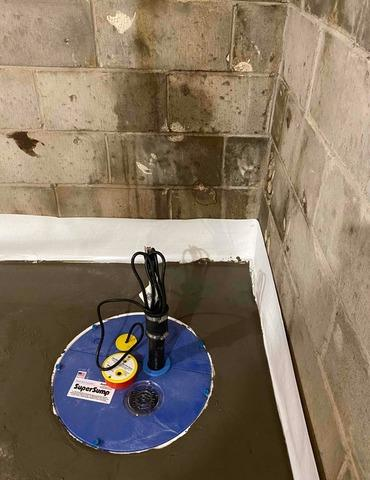 Installation of a sump pump in a basement in Mont-Tremblant, Qc