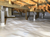 Addition of beams and support pillars in a crawl space in Massueville, Qc