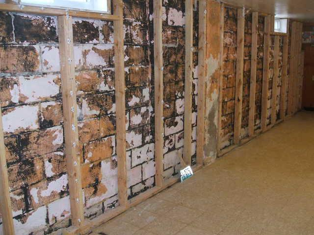 Bowing Foundation Wall Repair in Iowa - Before Photo