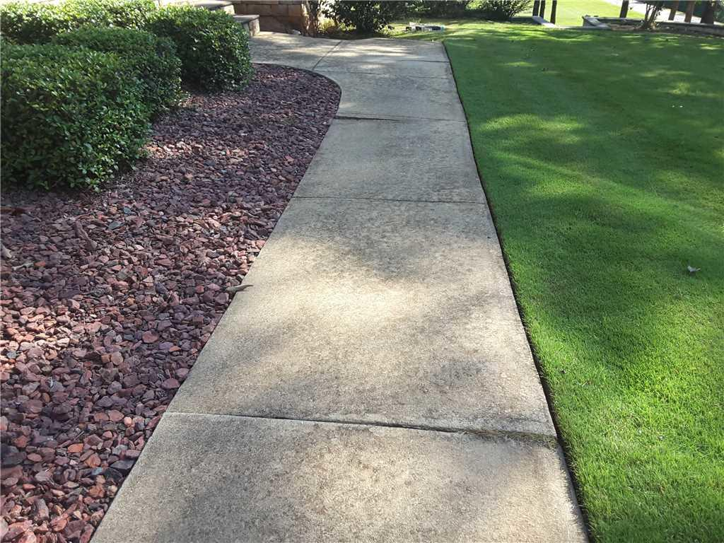 Tripping Hazard Removed from Forsyth, GA Sidewalk - Before Photo