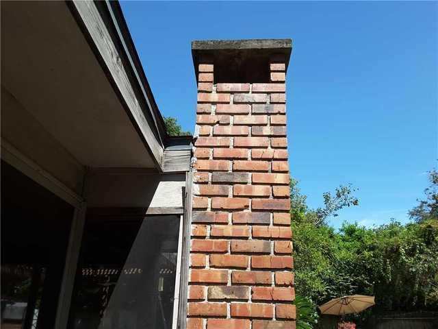 Leaning Brick Chimney Stabilized in Brunswick, GA