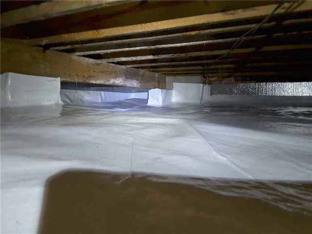Humid, Wet Crawl Space Encapsulated in Warner Robins, GA